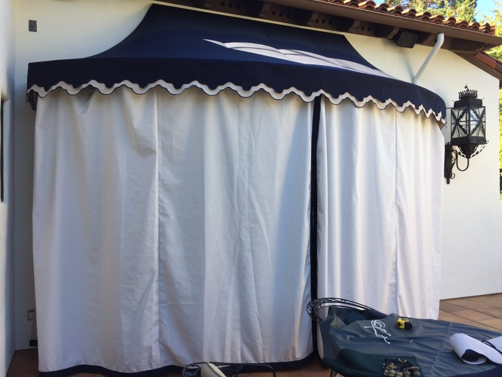 Sunbrella Door awning with double valance and closed Drapes