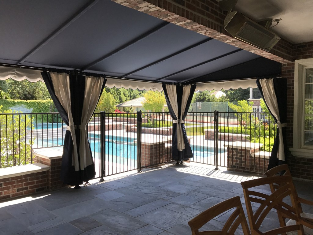 Sunbrella canopy with open drapes
