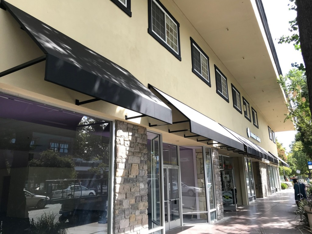 Storefront Open ended awnings using Firesist Black in Davis,CA