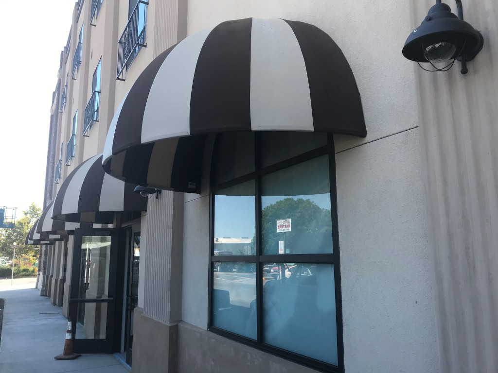 Winter's Hotel Domed awning using Sunbrella Fabric